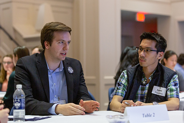 Alumnus speaks with students at a career event